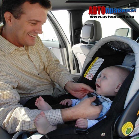Перевозка детей спереди